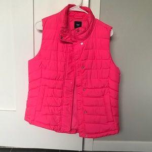 Neon pink puffer vest